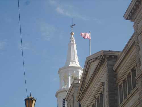 Beautiful white steeple and American Flag flying: Charleston Main Street