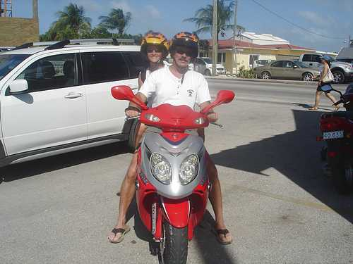 Rosella and Bill on scooter in Grand Cayman